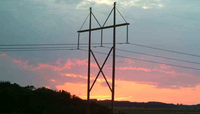 Transmission line with sunset in background