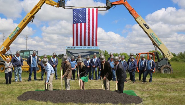 Individuals with shovels at a groundbreaking