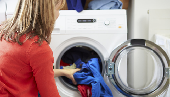 Lady taking clothes out of dryer