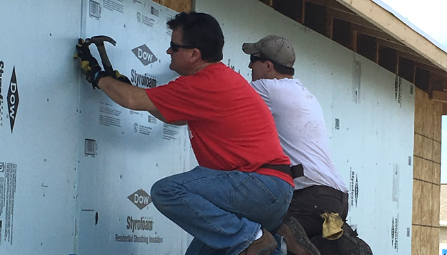 Ken Curry, Vice President of Customer & Corporate Services, working on a Habitat for Humanity home