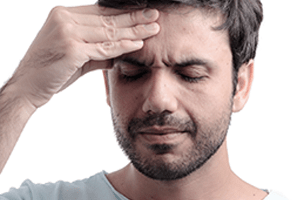Man suffering from a chronic sinusitis headache