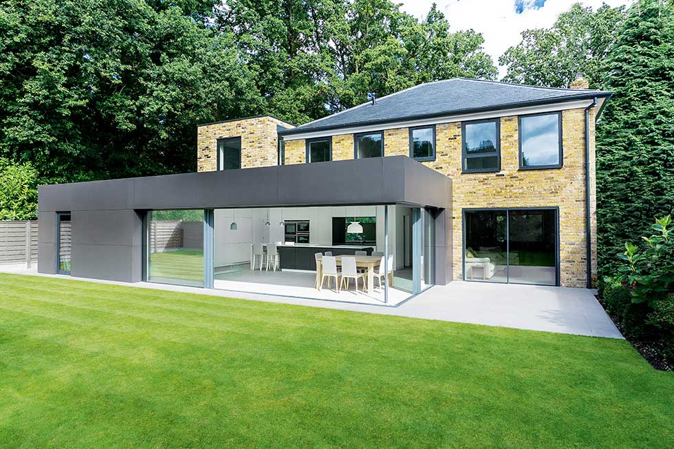 modern extension to brick clad house