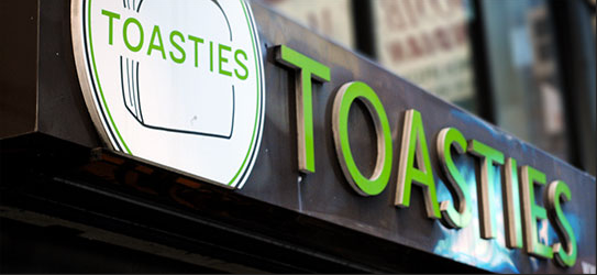 Toasties Sued By Delivery Workers for Wage Theft