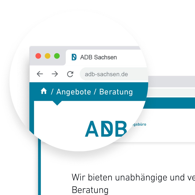 Lupe über der neuen Website, die das Breadcrumb und einen Teil des Logos hervorhebt