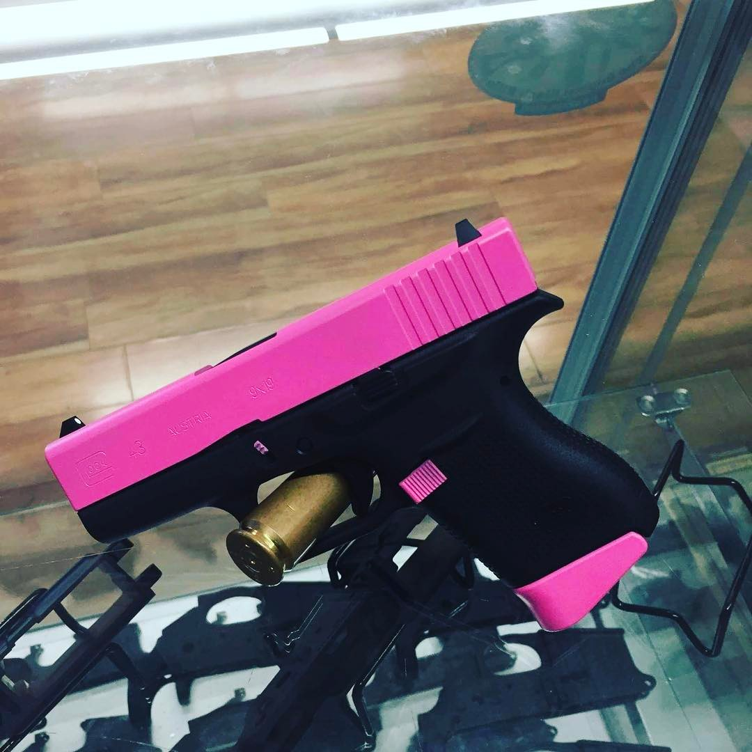 Pink and black Cerakote Gun
