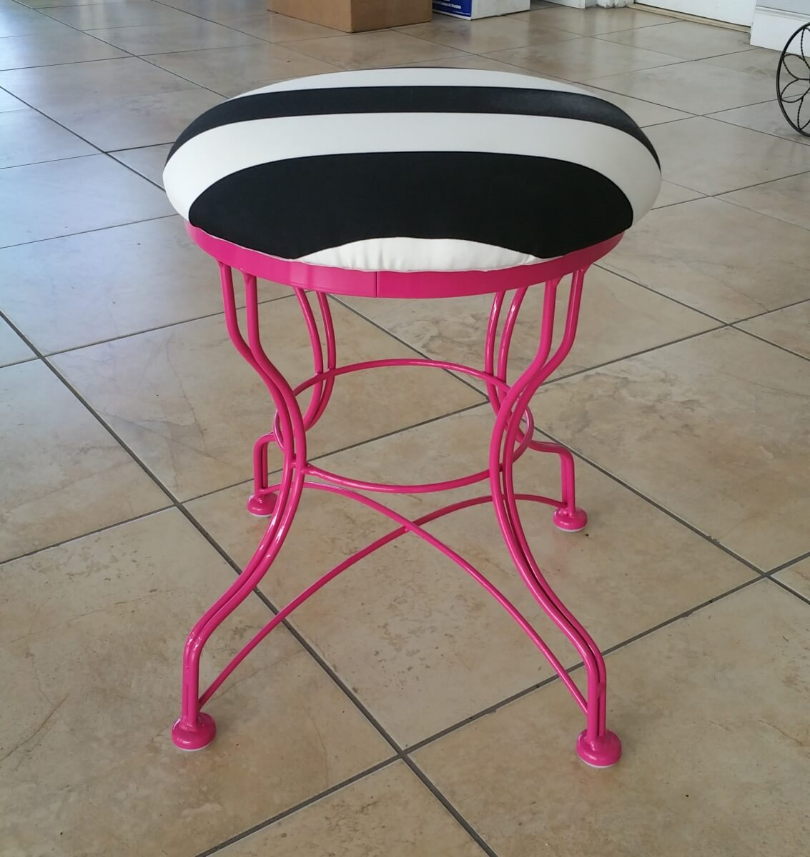 Pink legs and white and black stripped seat