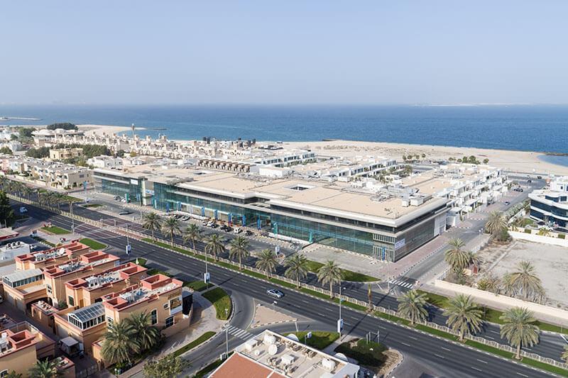 Dubai investment properties sunset mall sims alex ng maybank investment bank