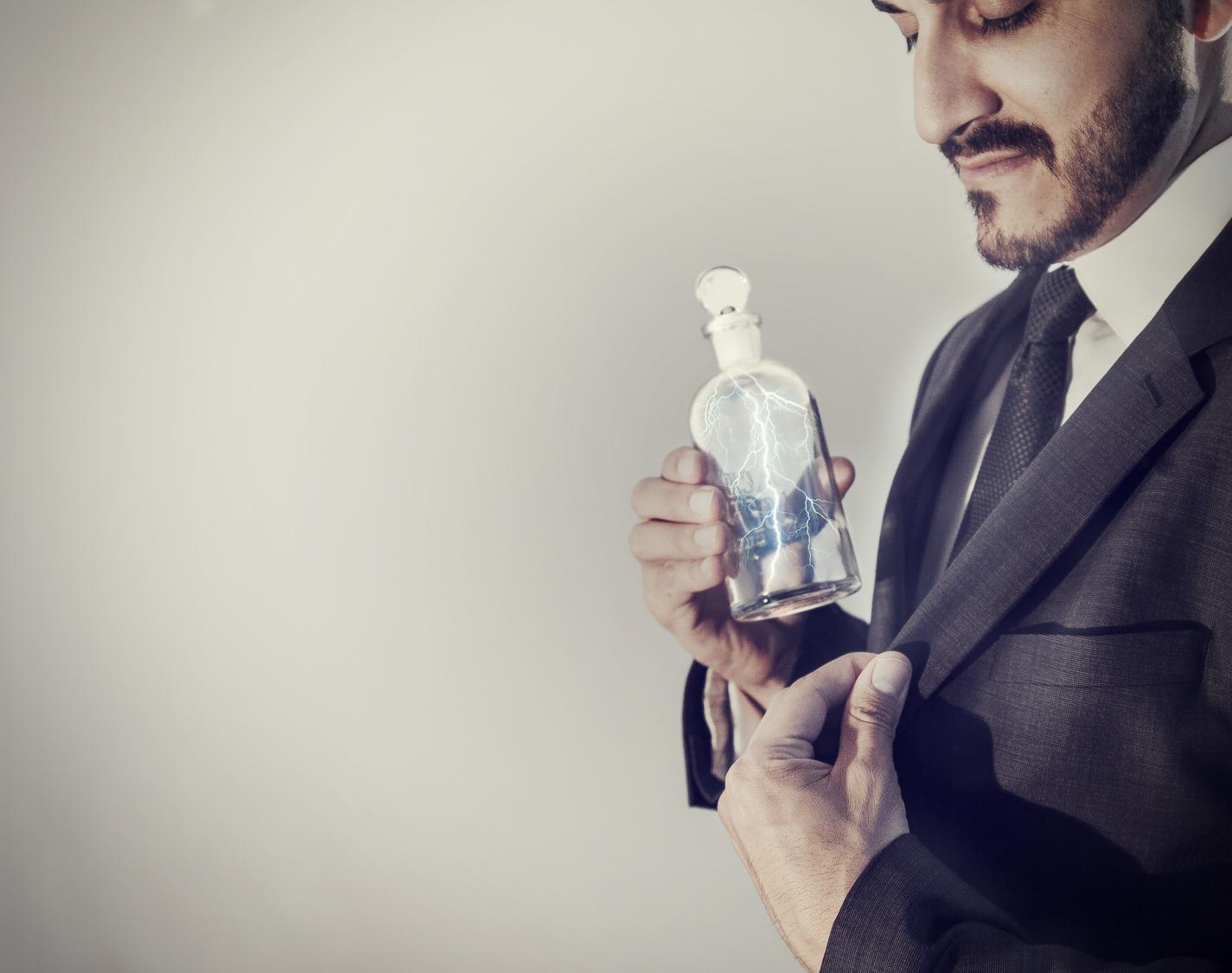 business man puts bottle of lightning in his pocket