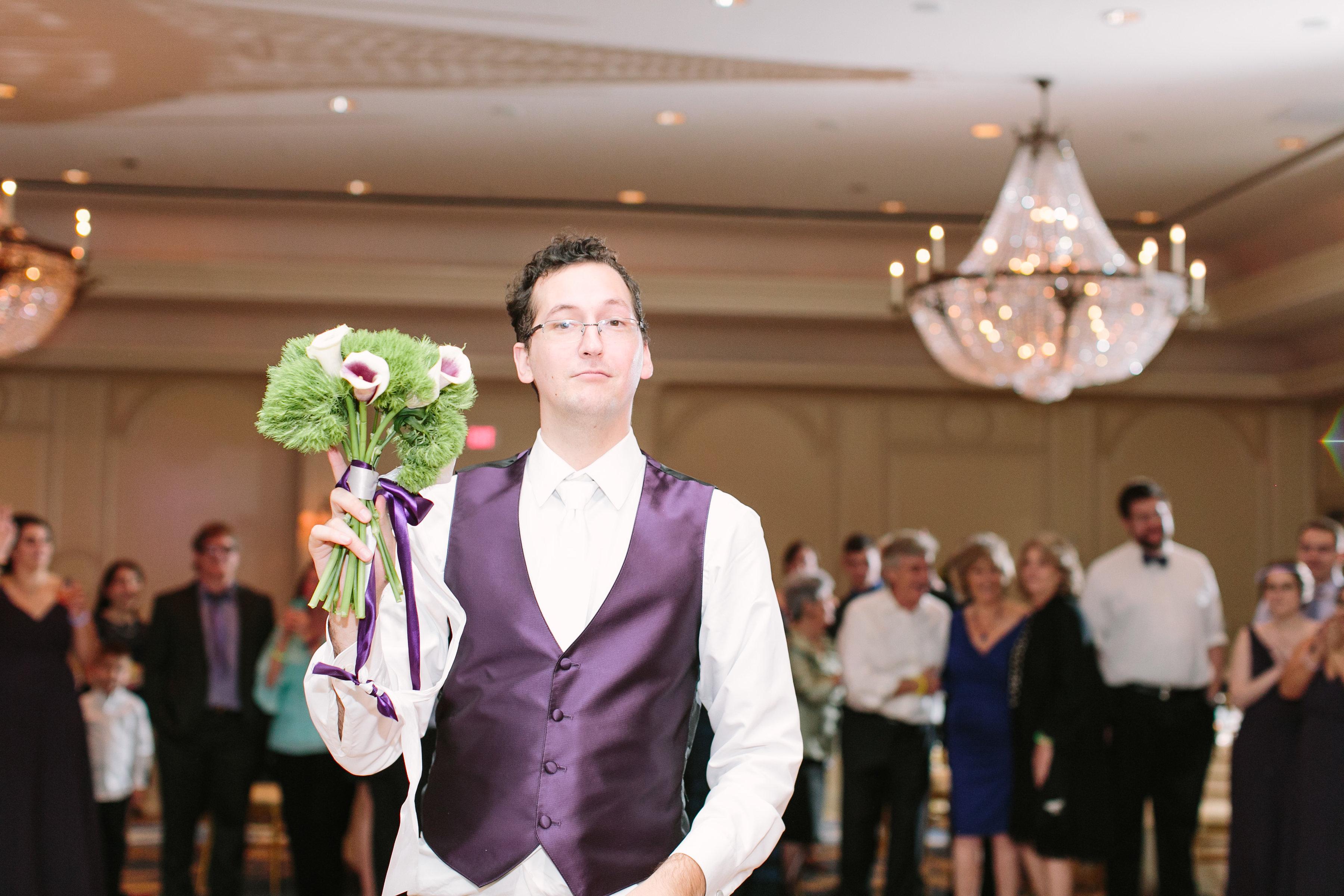 groom bouquet toss purpple flowers richmond wedding florist virginia