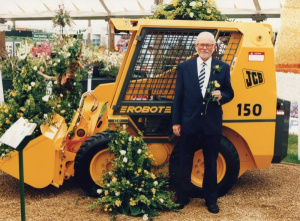 Planting flowers with a JCB