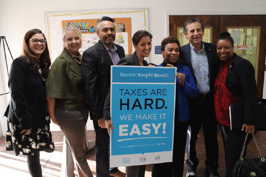 Group of City of Oakland officials and mayor Libby Schaaf holding EITC sign that reads Earn it, Keep it , Save it