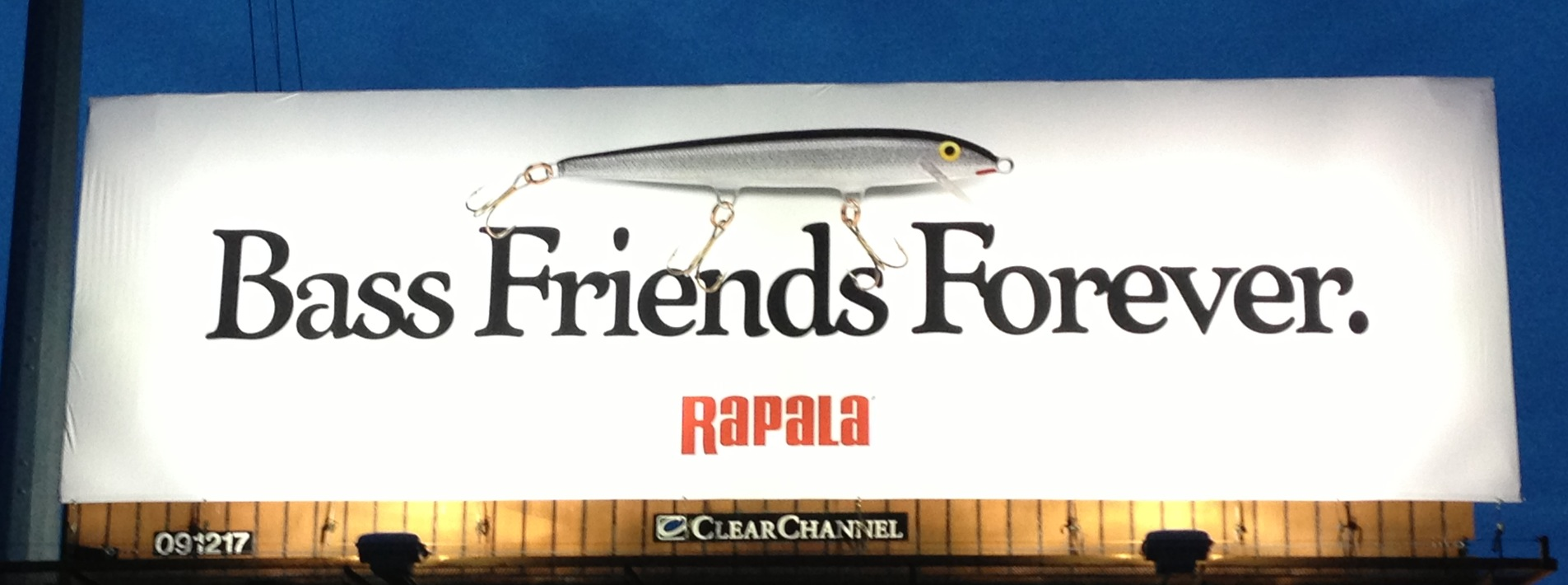 "Billboard with a fish pun, ""Bass Friends Forever"""
