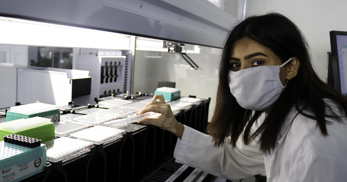 Terramera female scientist working with liquid handling robot
