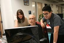 ServiceRocket workers helping customers on  Atlassian Software training.