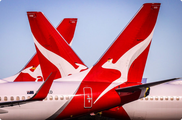 Tail of a Qantas Airways plane on the landing track on a sunny day
