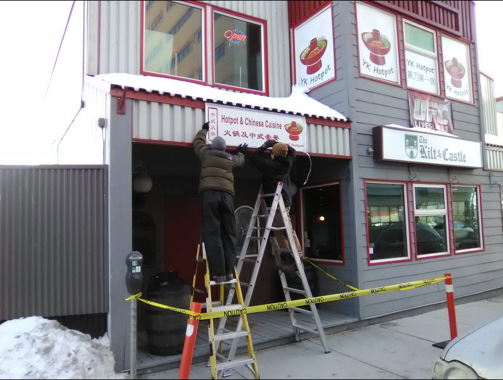 Exterior store signage and backlit sign for Yellowknife restaurant.