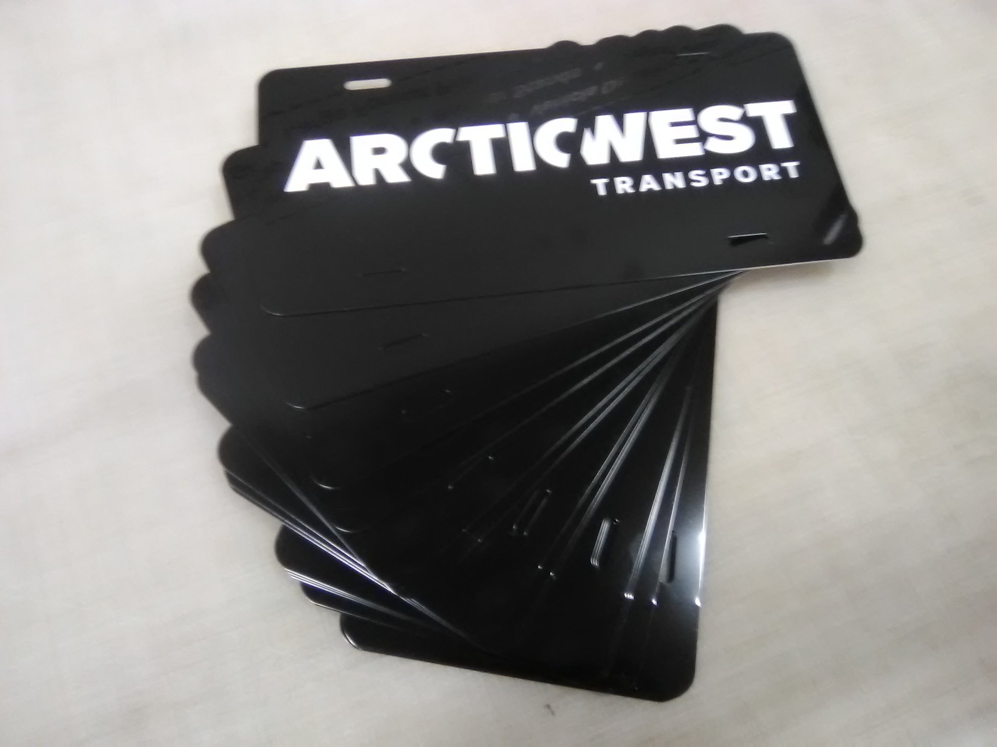 Custom branded fleet decals and fleet numbers for Arcticwest Transport