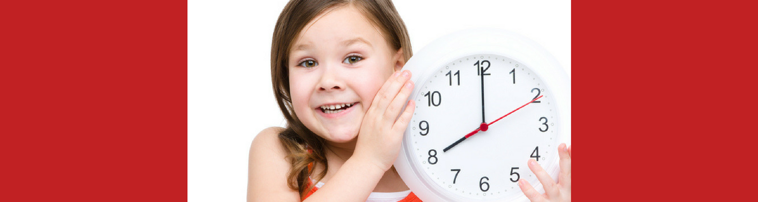 Girl holding clock to symbolize time running out.