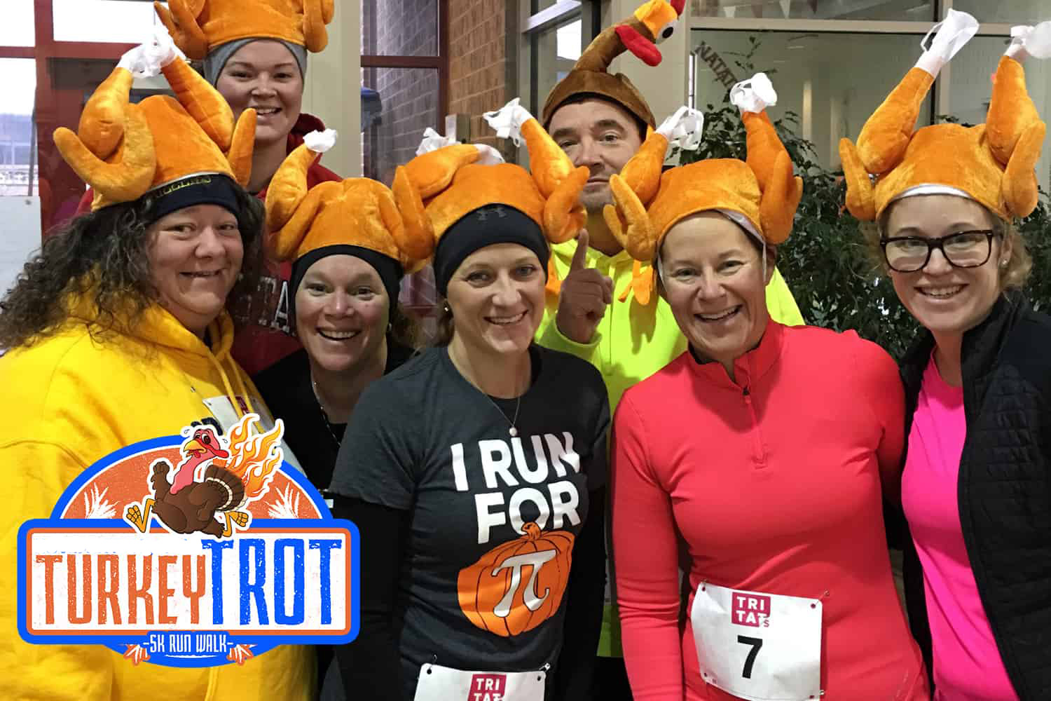Turkey trot participants wearing turkey hats