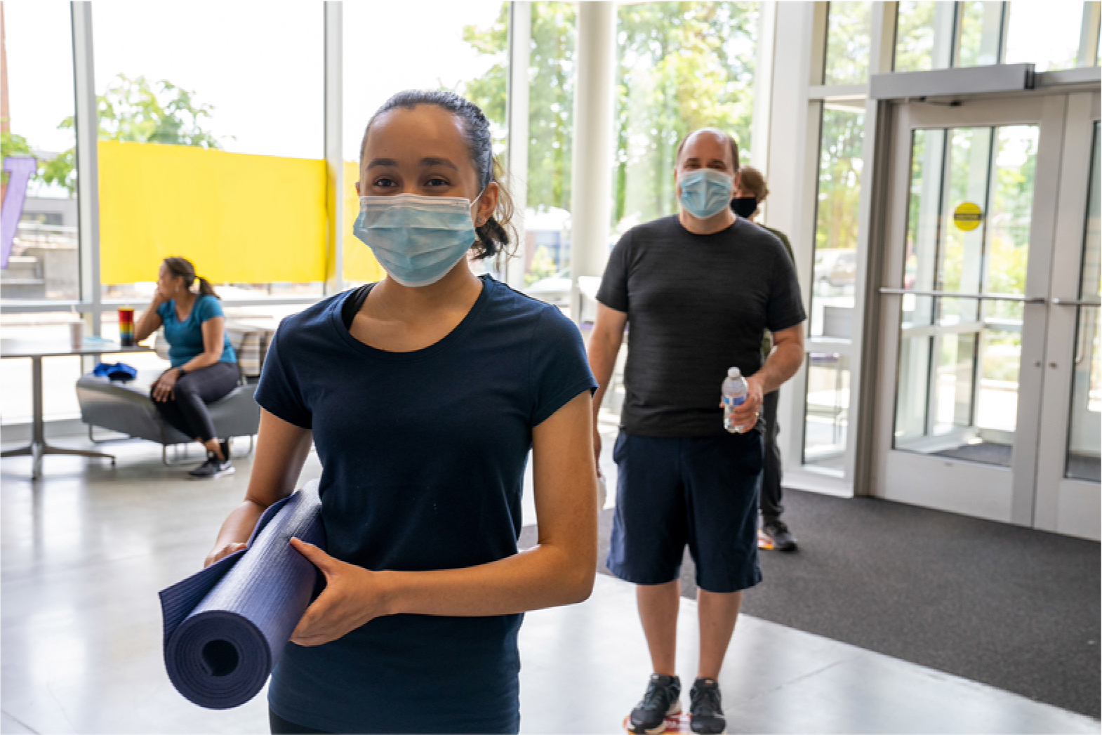 Henry County YMCA members wearing masks and coming for group exercise classes.
