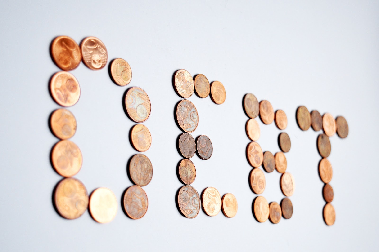 coins forming a debt word