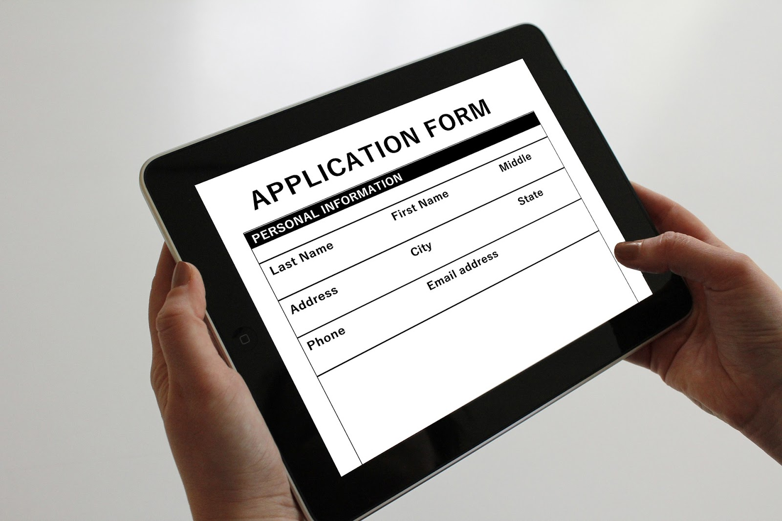 looking at application form in tablet device
