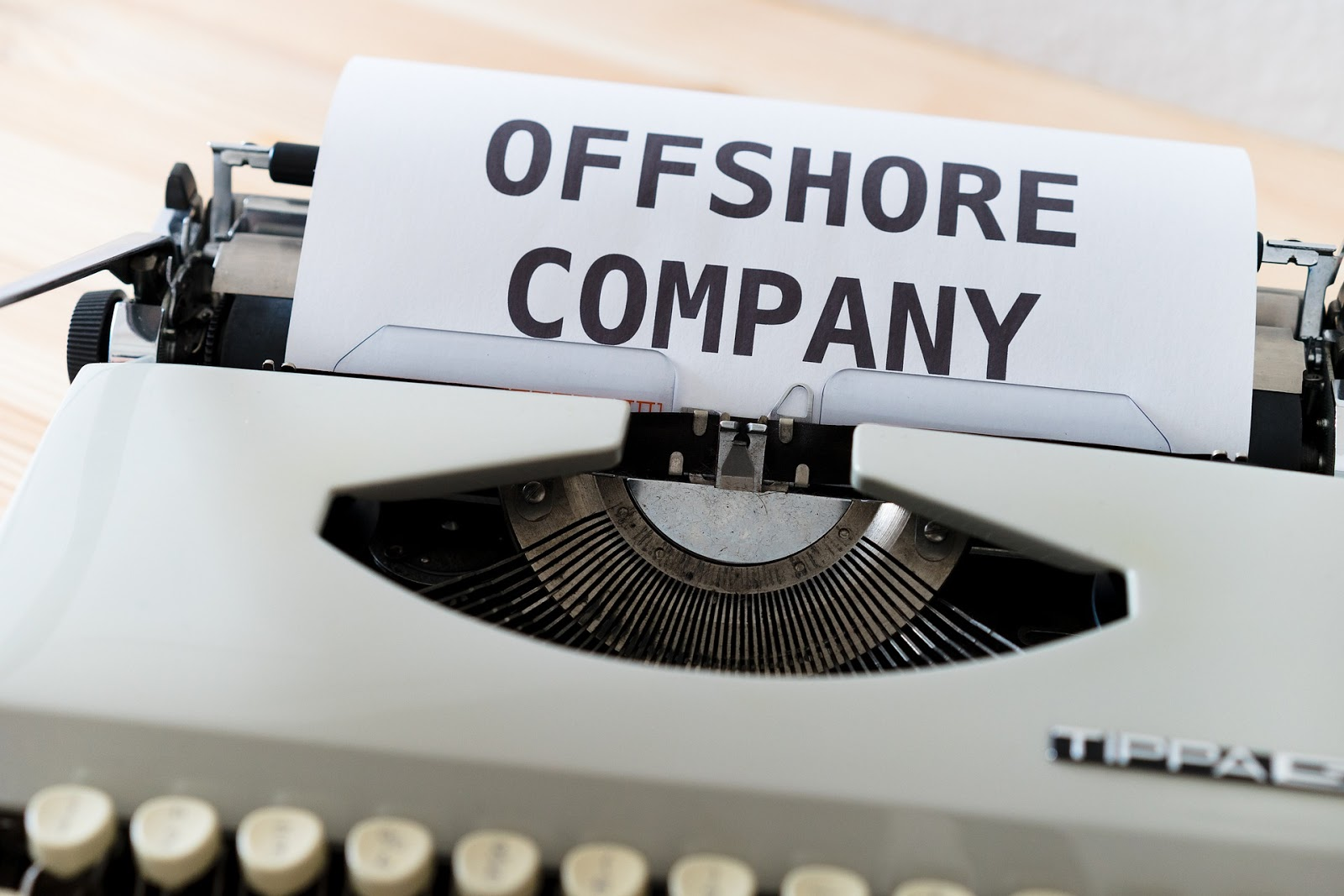 offshore company word in typewriter