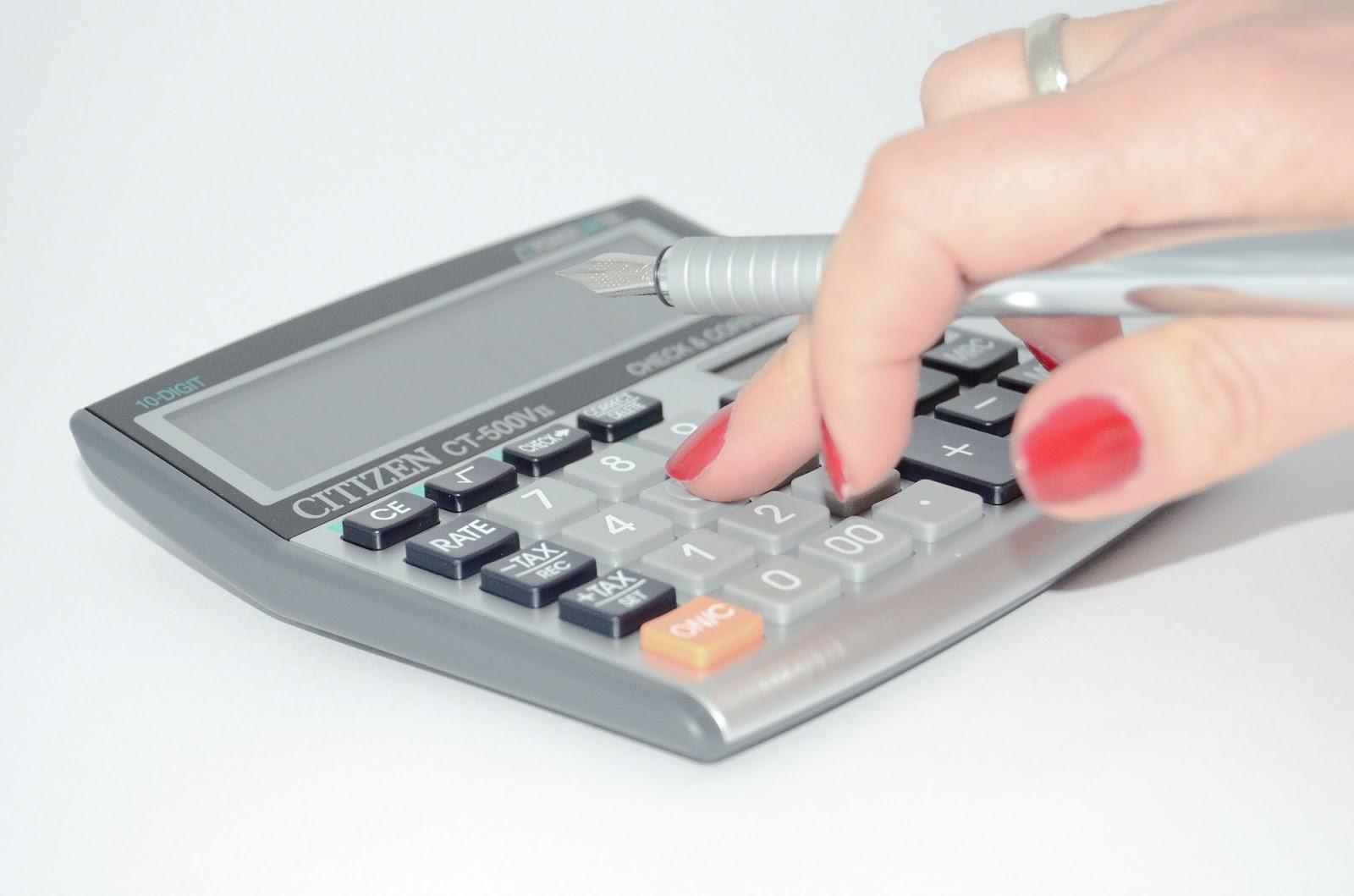 calculating expenses using a calculator