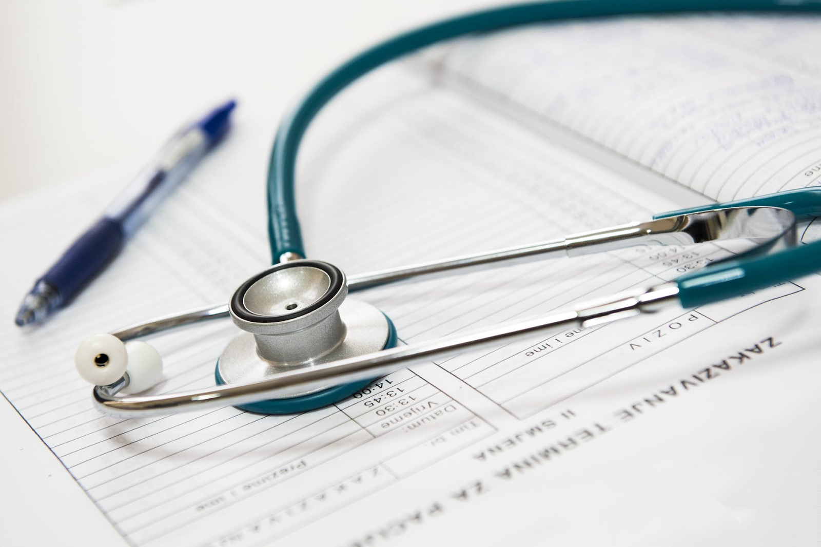 Talent retention: Stethoscope and medical log represent health benefits