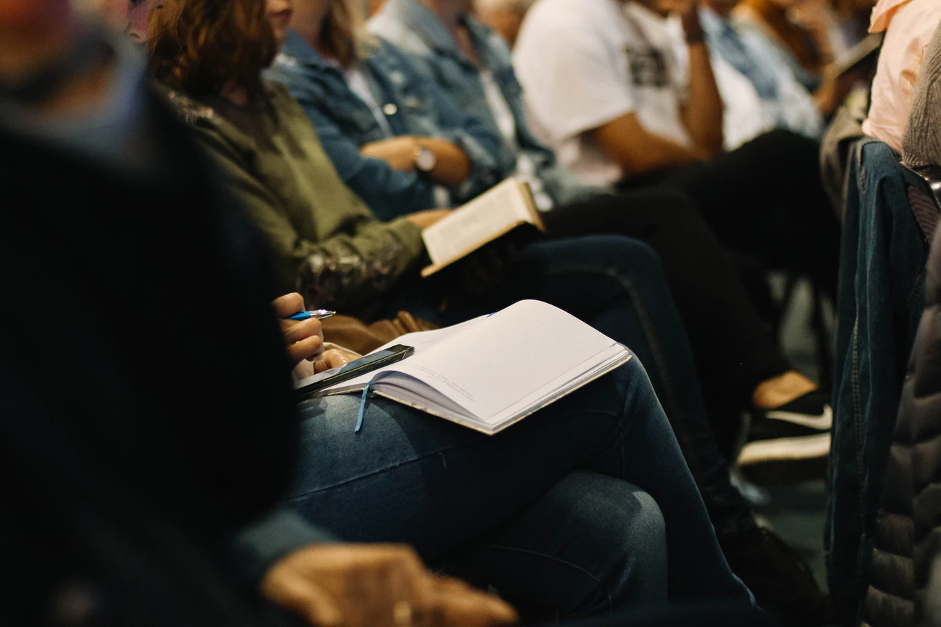 Communication failure: Team members take notes at a business lecture