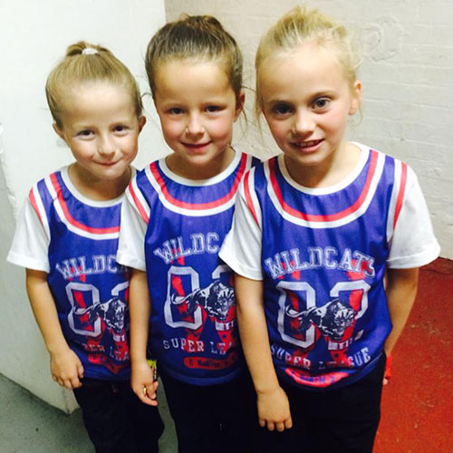 Amy Young Dance kids party entertainment. Children wearing wildcats team shirts