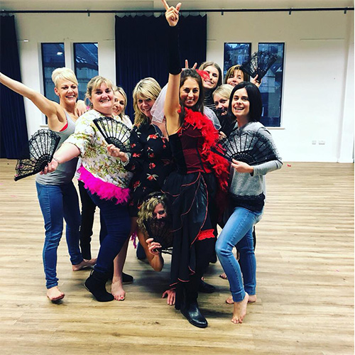 Hen party activities in Bath and Bristol with Amy Young Dance. image of women after an event with fans.