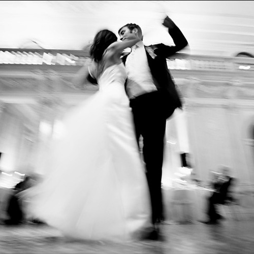 Black and white image of couple ballroom dancing at wedding after wedding dance lessons with Amy Young Dance