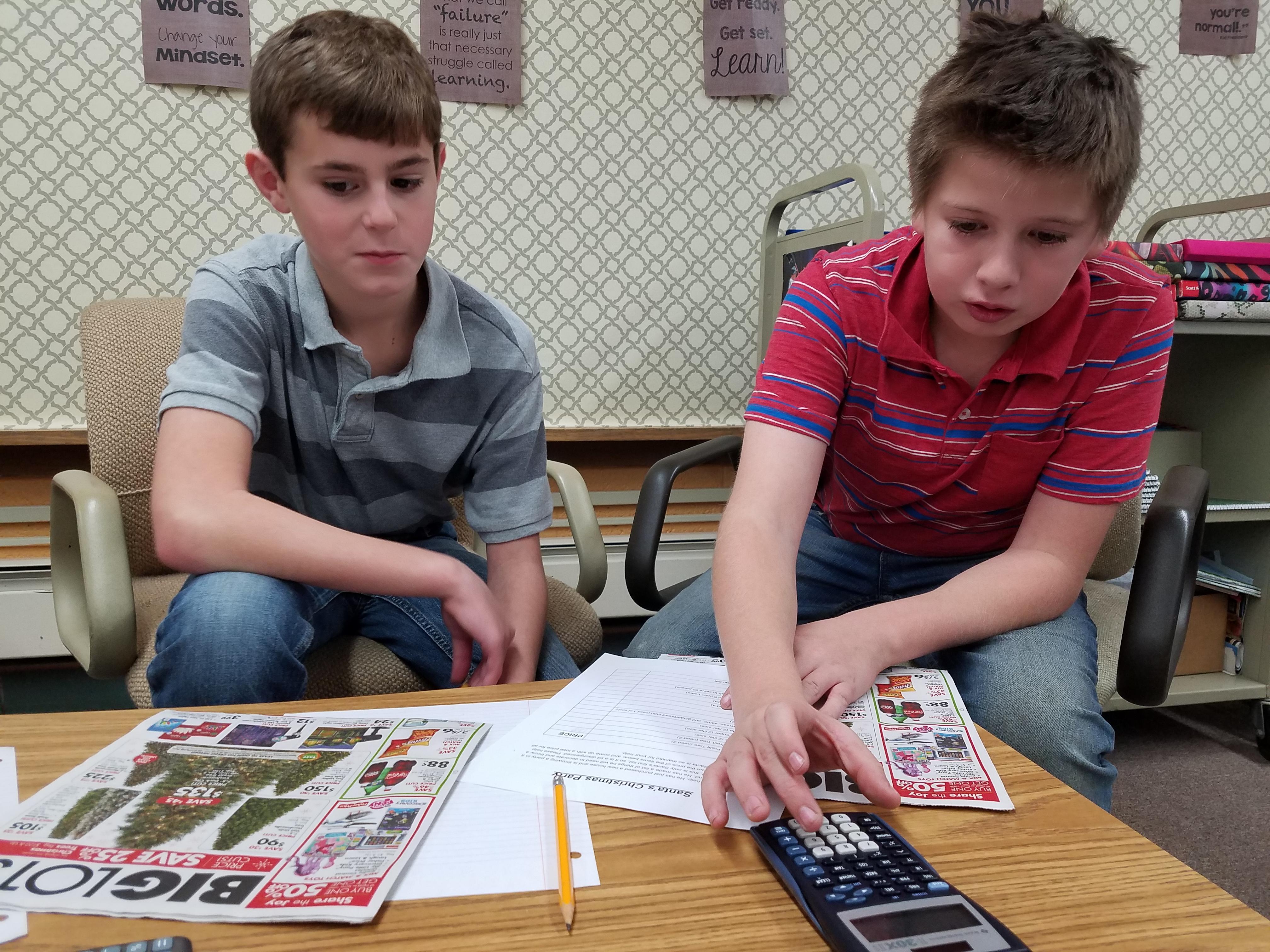 two boys doing math