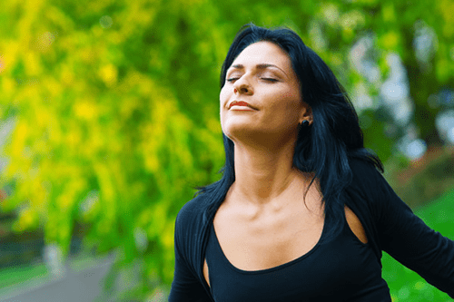 Woman enjoys life free from sinus infections.