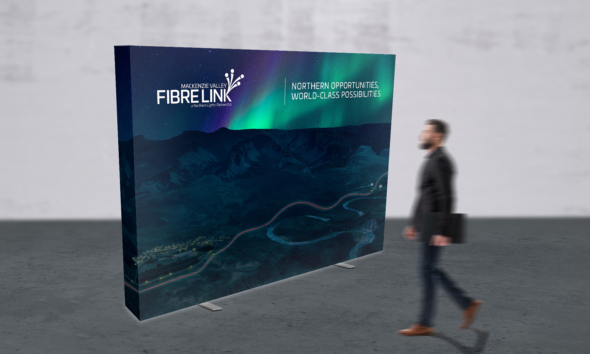 Print design sample of backlit trade show booth for Mackenzie Valley Fibrelink.