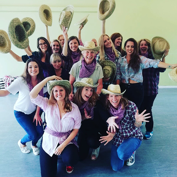 Amy Young line dance hen party in Bath. Women wearing cowgirl hats.