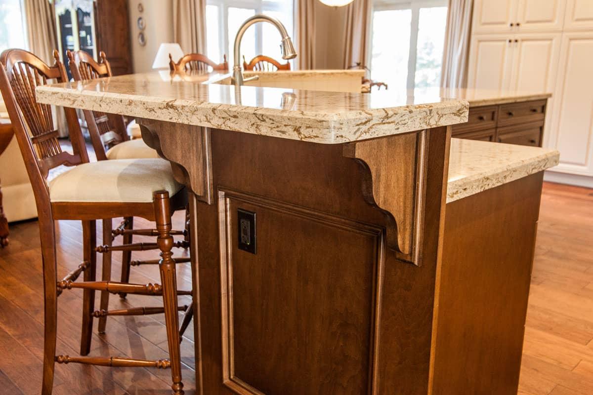 1 Traditional custom vanity with dark wood cabinets.