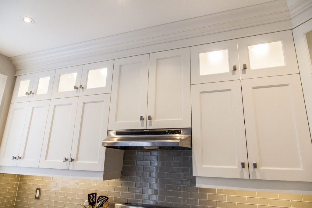 White kitchen with frosted glass upper cabinets