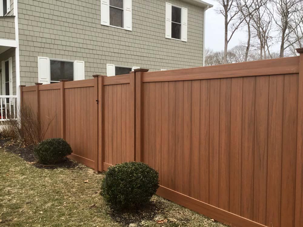 Cedar grain PVC fence installed in Southampton, NY