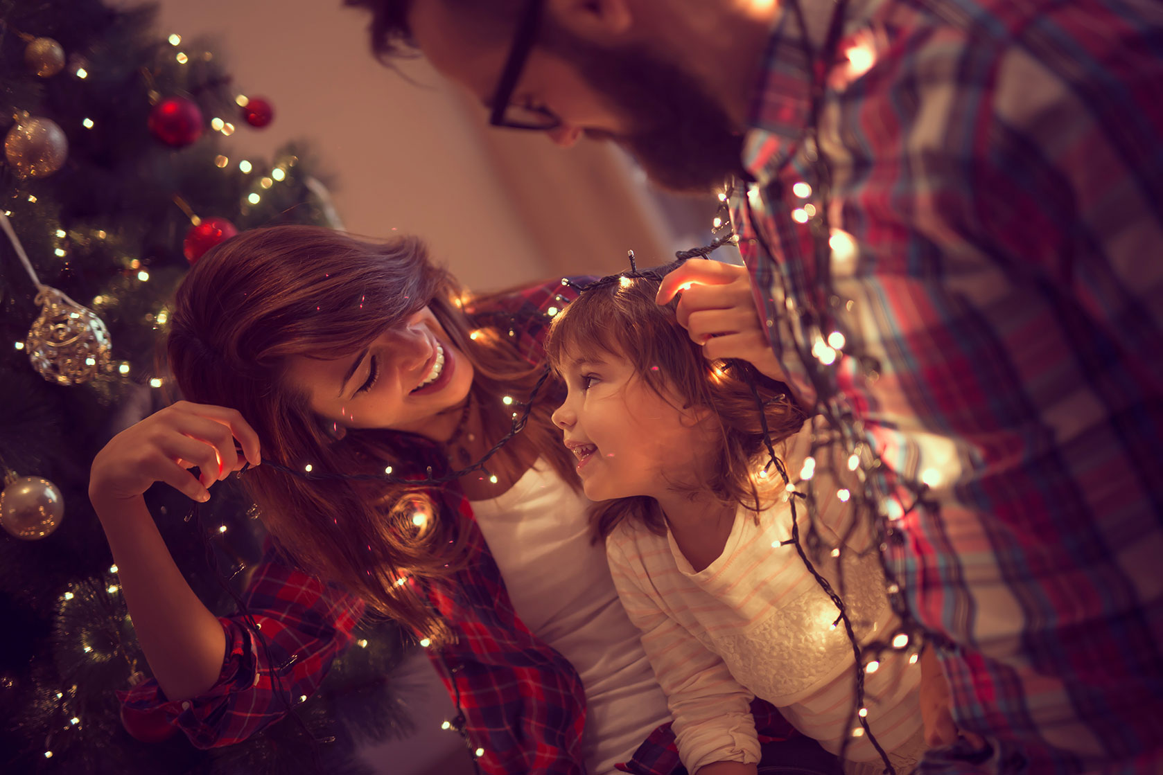 Happy family around a Christmas tree