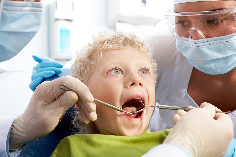 Young boy receiving dental treatment