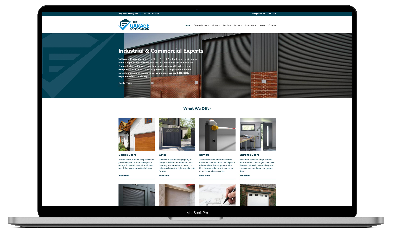 The Garage Door Company website open on a Macbook pro