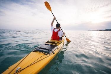 Man kayaking in the water