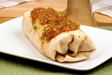 Large burrito with salsa on top