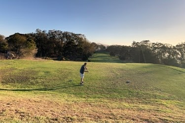 Man playing golf at Morro Bay Golf Course