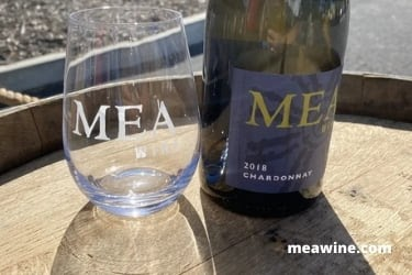 MEA glass with a Chardonnay bottle