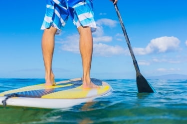 Man paddleboarding with a nice weather