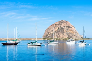 Morro Bay with fishing boats nearby