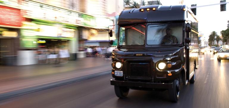 UPS truck driving down street
